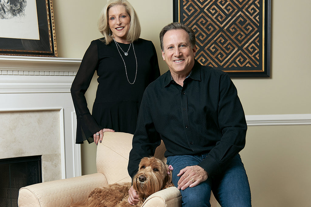 Janet and Bruce Beck at their White Plains home with labradoodle Madison.