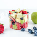 a fruit salad made with watermelon, pineapple, green apple, strawberry and blueberry