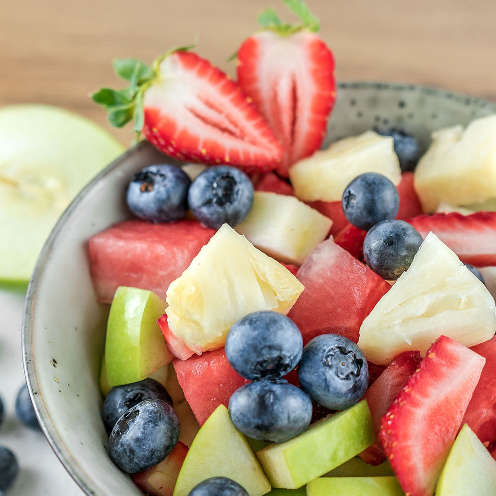 Close-up of a fruit salad made with watermelon, pineapple, green apple, strawberry and blueberry