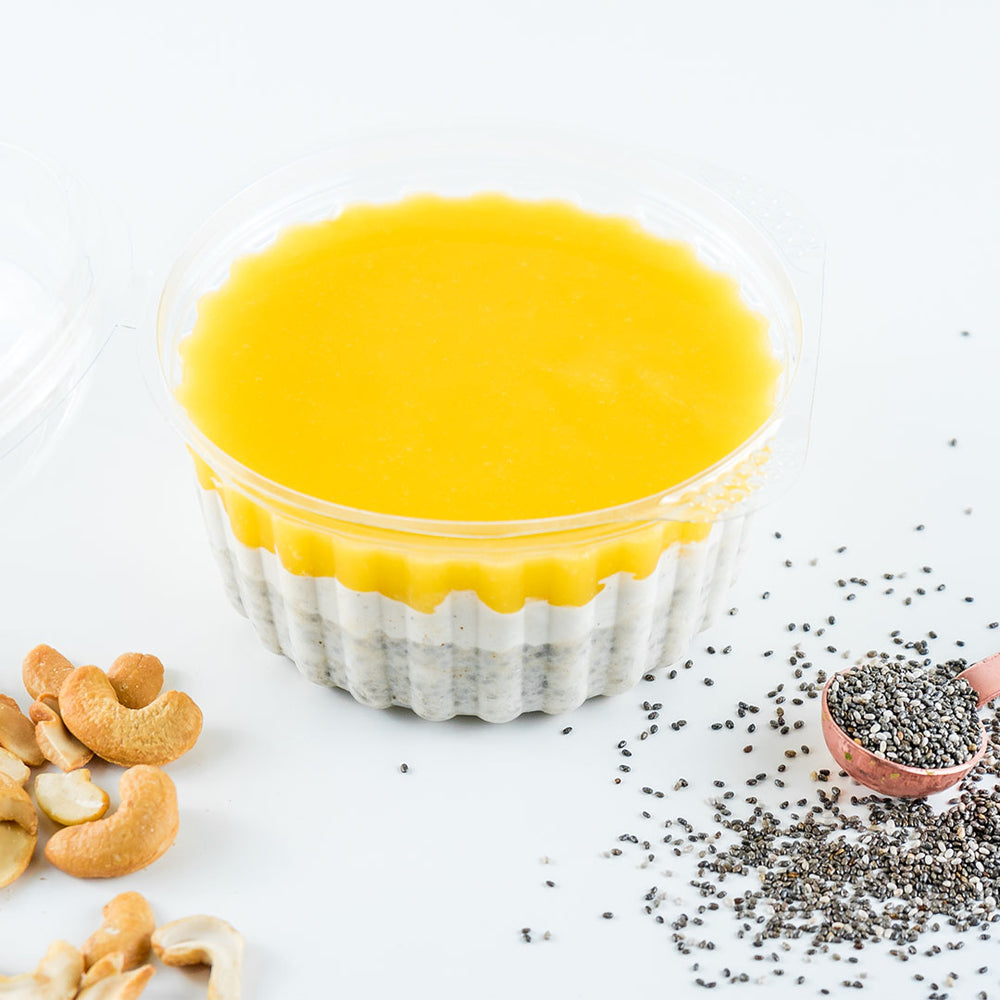 a mango chia pudding with chia seeds and cashews