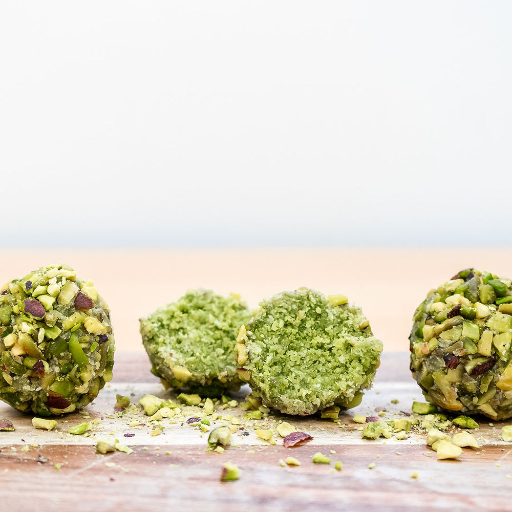 matcha protein balls with one cut in half
