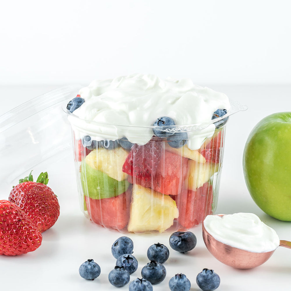 a fruit salad topped with Greek yoghurt