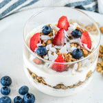 Yoghurt and Granola with blueberries and strawberries