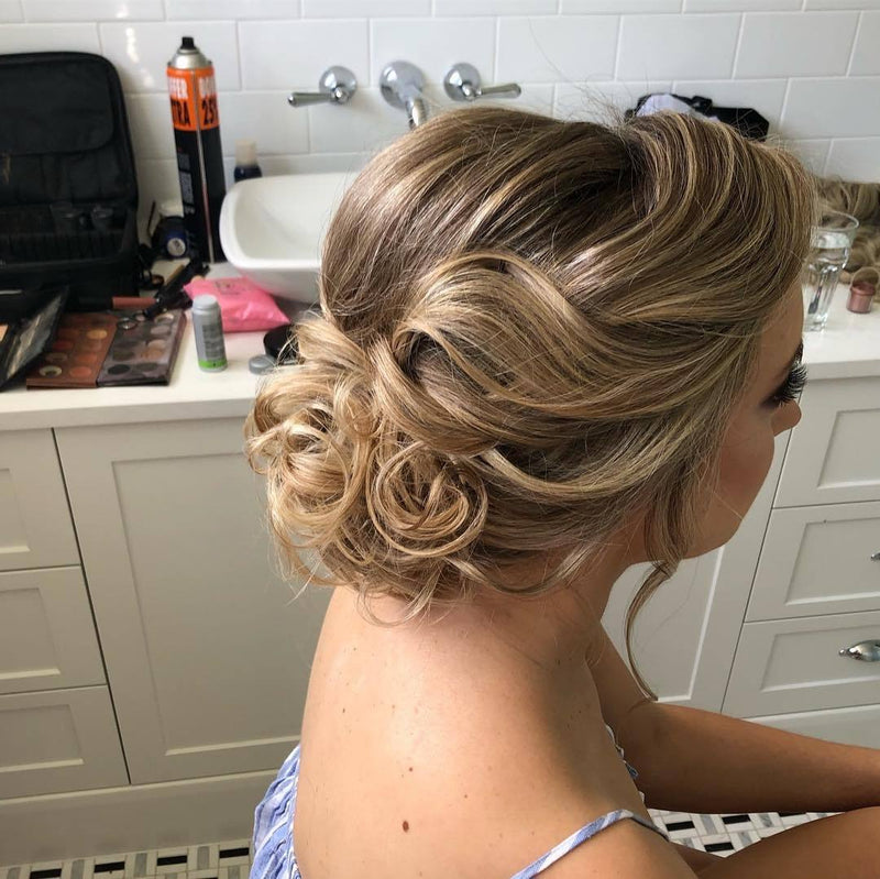 Bridal low messy bun hairstyle in Sydney