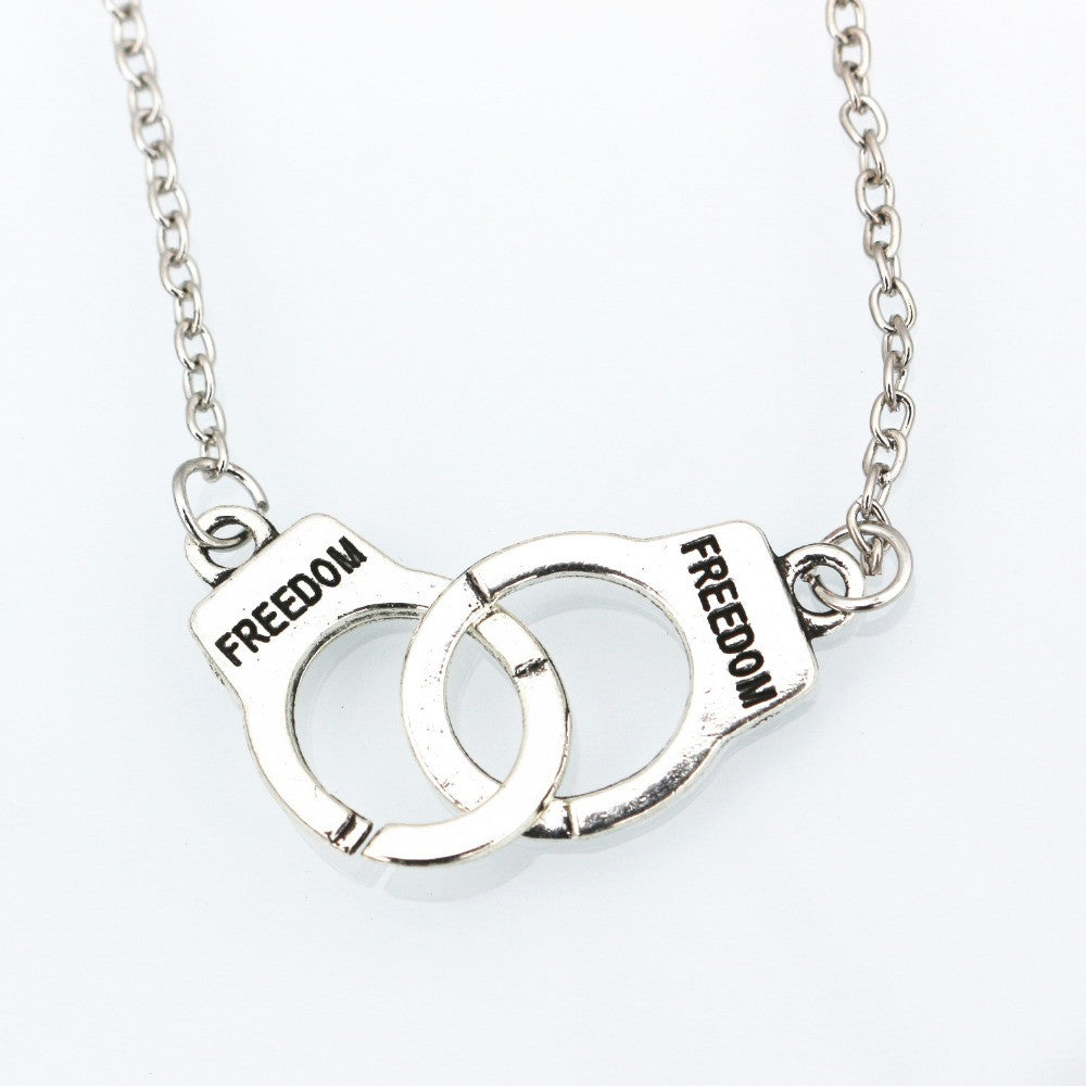 Lovers handcuff necklace one tribe shop lovers handcuff necklace aloadofball Image collections