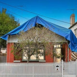 house covered in tarp