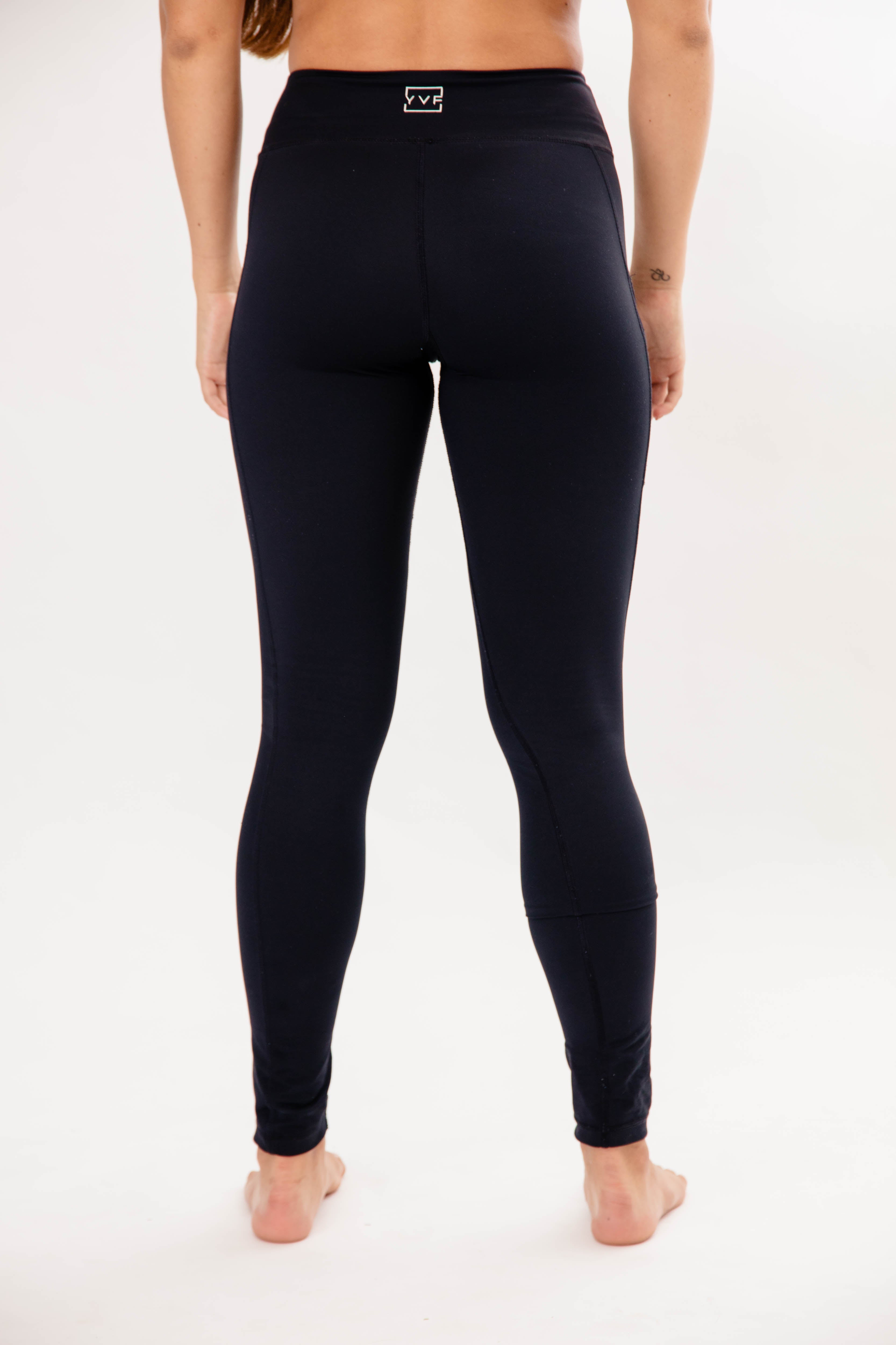 rear view of girl wearing black leggings with pocket