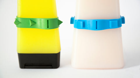 Two bathroom bottles with a green and yellow Band-it