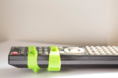 green-band-wrapped-around-remote-control