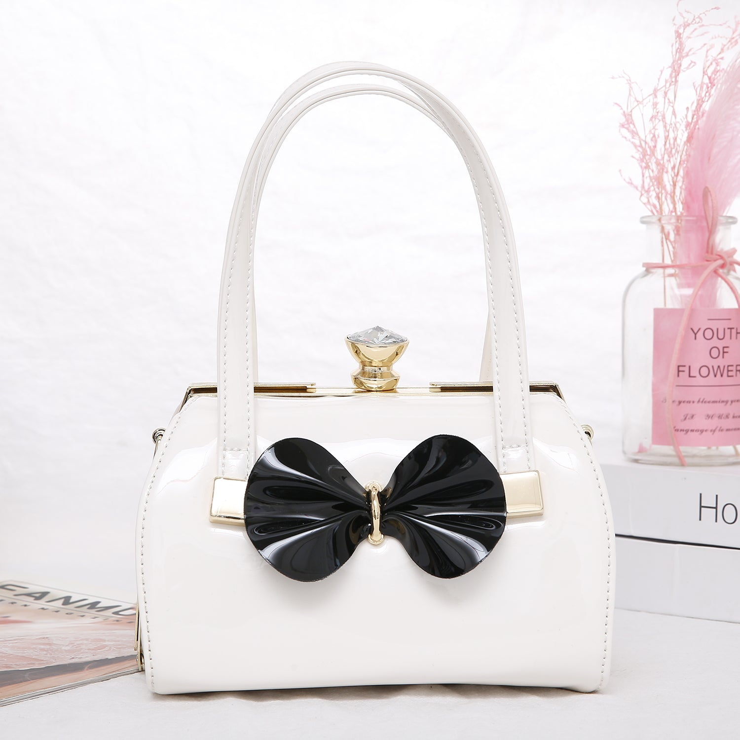 Erica White Patent Handbag with Black Bow