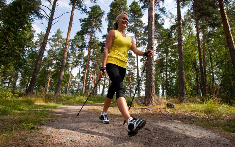 Woman Nordic Walking in the woods