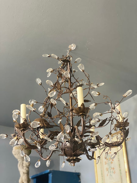 Contemporary crystal chandelier with interesting metal leaf detail
