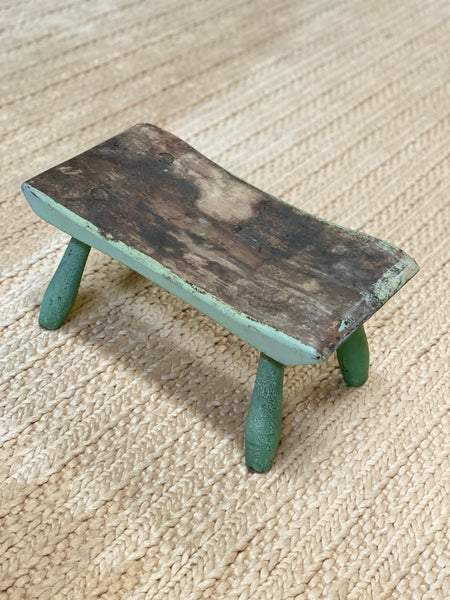 Diminutive footstool in great old paint. Hand carved c 1880