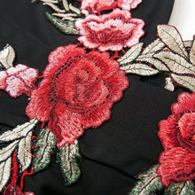 V- neck black dress with embroidered flowers