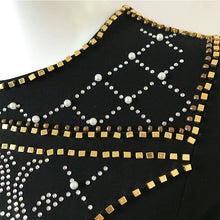 Black bodycon dress with rhinestones