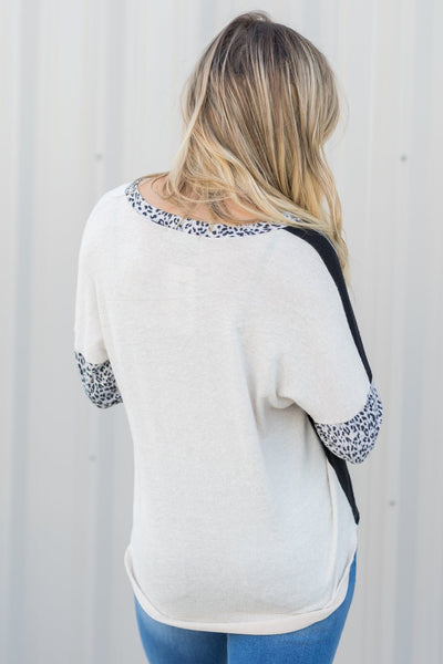 Sunrise Creeping In Long Sleeve Color Block And Animal Print Top In Black And Cream - Filly Flair