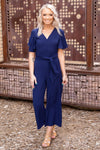 Wherever You're At Short Sleeve Tie Jumpsuit in Navy - Filly Flair
