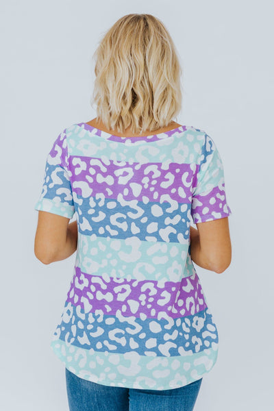 On The Hunt Animal Print V-Neck Short Sleeve Top in Purple - Filly Flair