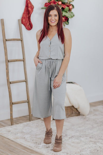 What Love Is Jumpsuit Pockets Button Down V Neck Sleeveless Elastic Tie Waist in Sage - Filly Flair