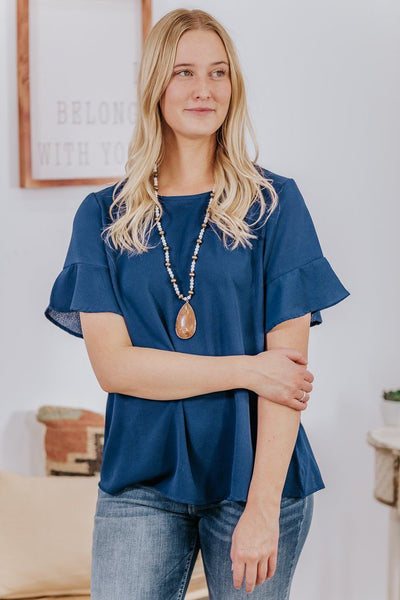 They Know It Pebble Crepe Bell Short Sleeve Top in Navy - Filly Flair