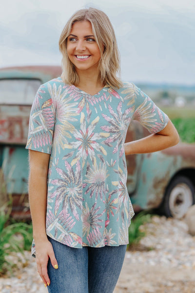 I Will Survive Feather Print Short Sleeve Top in Green - Filly Flair