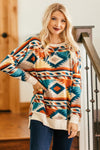 Everything Happens Aztec High Low Long Sleeve Top in Orange Blue - Filly Flair