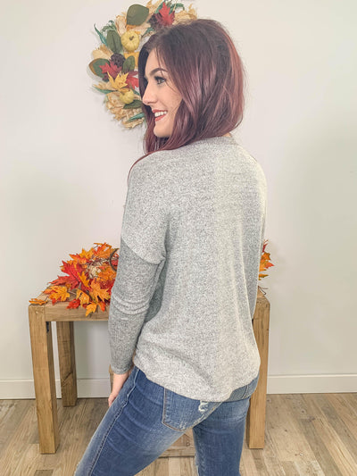 Captivating You Long Sleeve V Neck Twisted Hem Shirt in Grey - Filly Flair