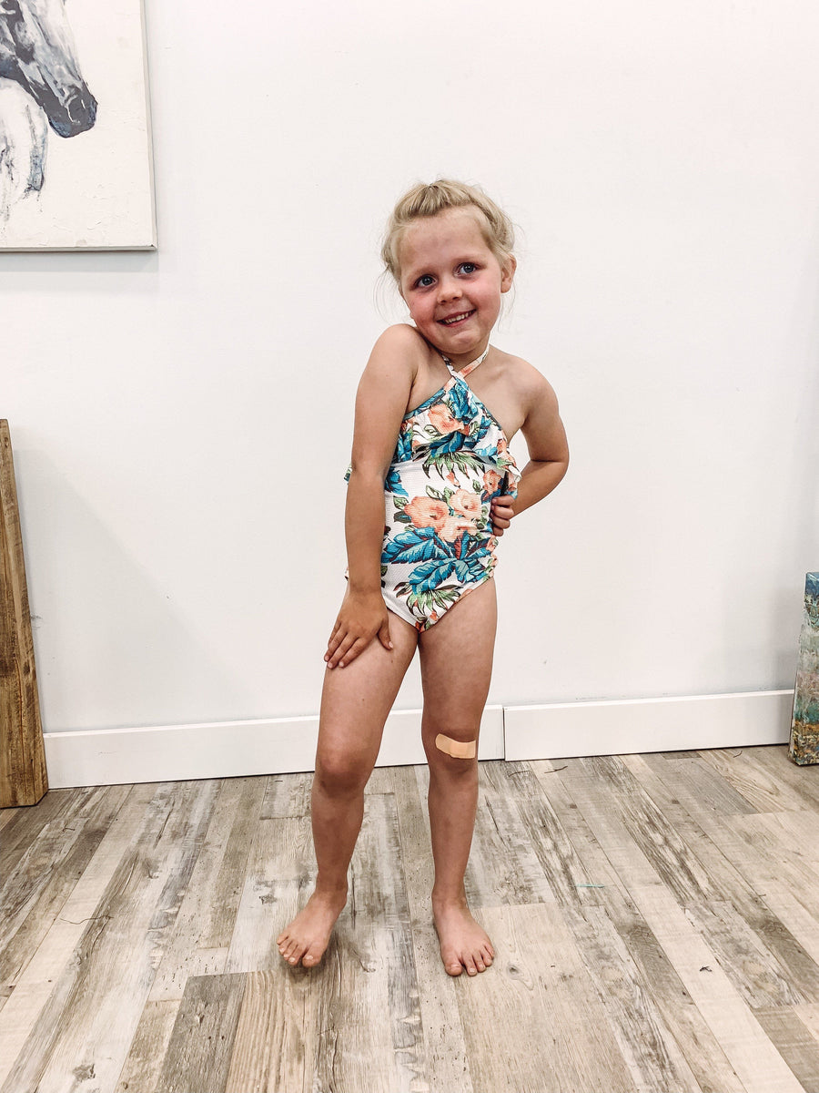 ab0b9252c4543 KIDS SWIM: Do It For You Textured Floral Halter One Piece Suit in Blue Peach