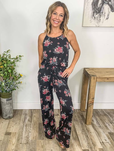 More Doing Sleeveless Floral Elastic Waist Jumpsuit in Black - Filly Flair