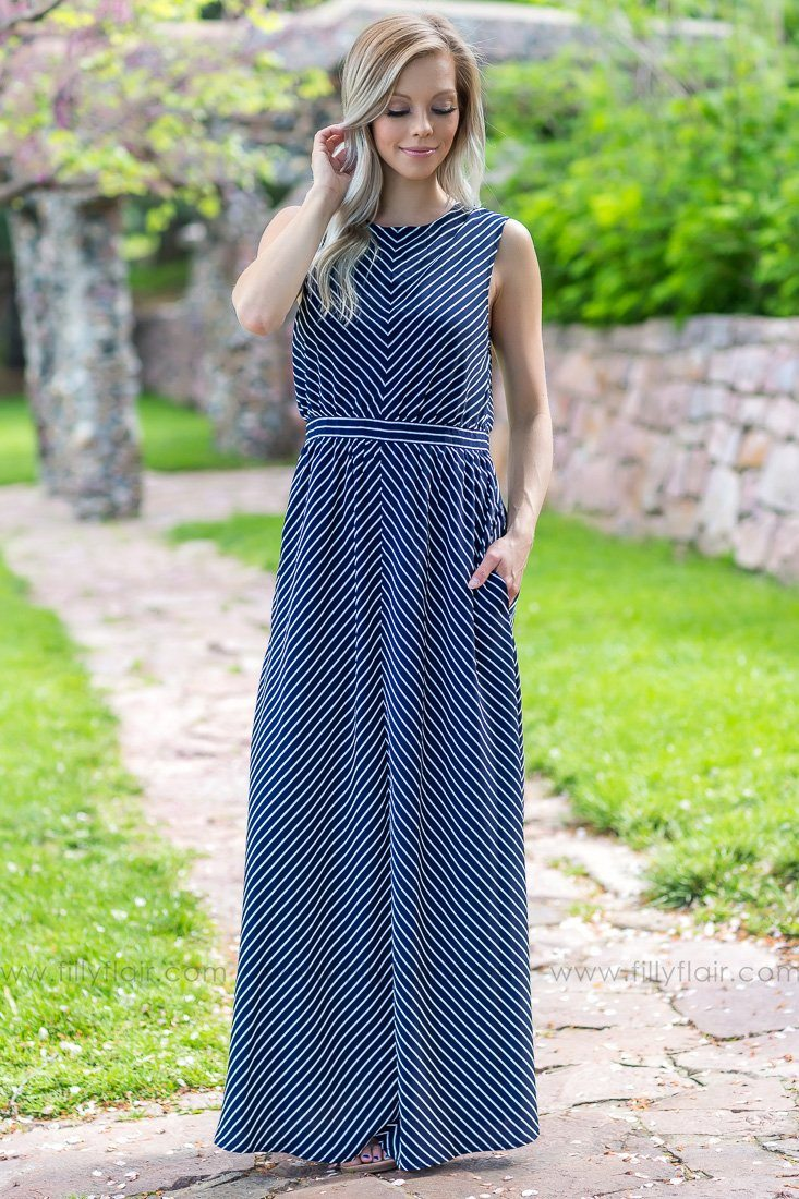 What Gives Sleeveless Striped Pocket Maxi Dress In Navy - Filly Flair