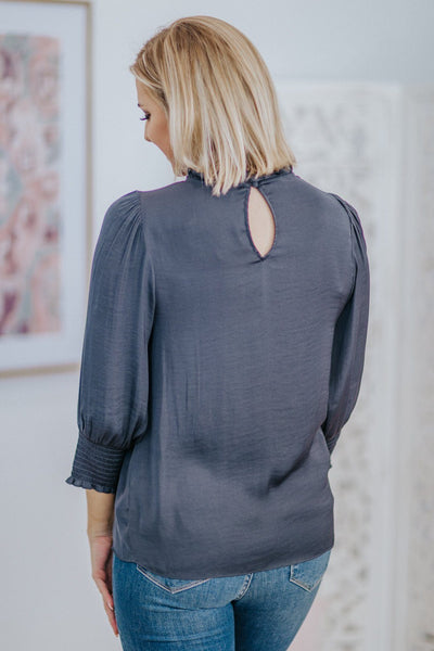 Nothing Worth Having Comes Easy Ruffle Mock Neck Elastic 3/4 Sleeve Blouse in Charcoal - Filly Flair