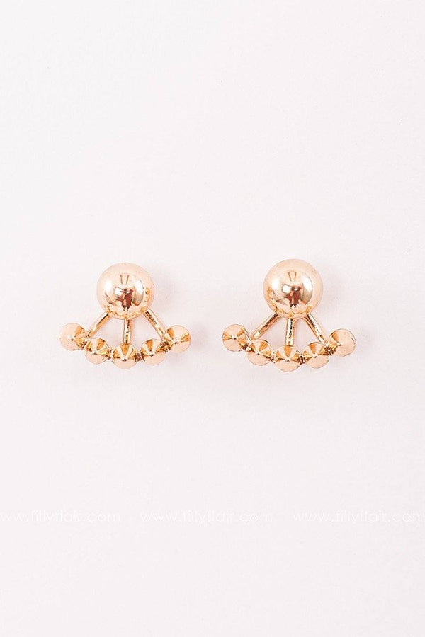 Gold studded earrings
