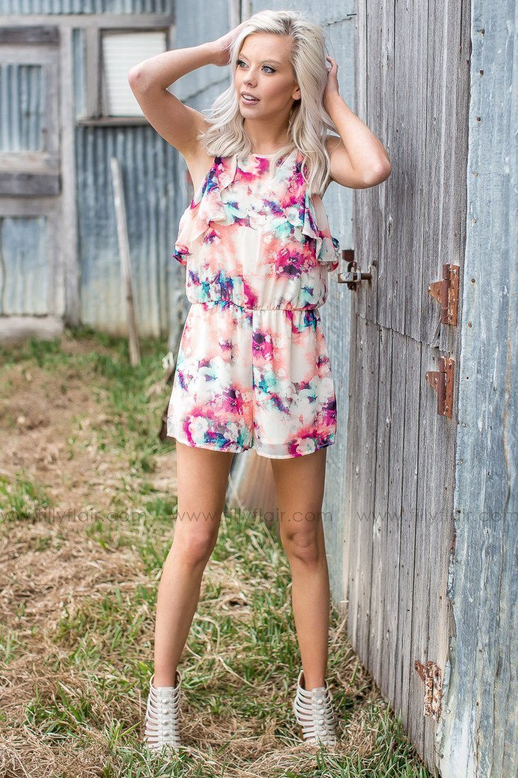 bright colored romper with ruffles