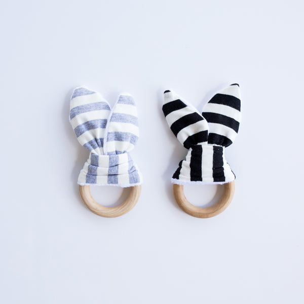 Perfect baby shower gift! Babies love the crinkling noise that it makes! There's a crinkly material sewn between the fabric to stimulate babies senses. Gray stripe or Black and White Stripe.