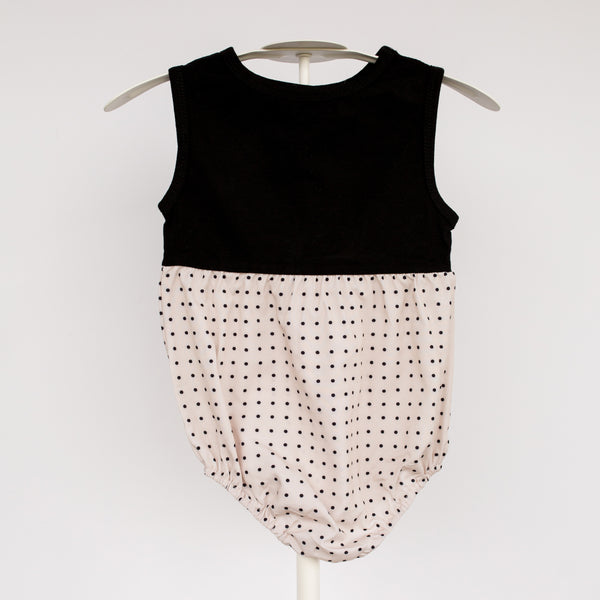 Gorgeous classic dot baby romper! Soft and light weight for Spring and summer. We also love it paired with leggings and layers. Has snaps for convenient changing.