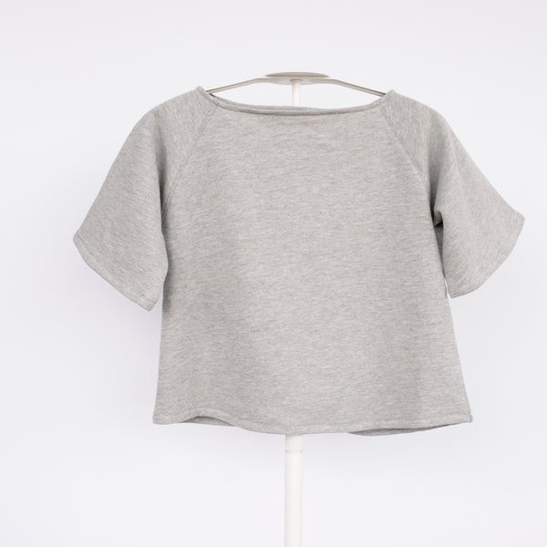 Cozy, lightweight off-the-shoulder sweatshirt. 100% cotton. Perfect for layering in cooler months or wear it as a tunic as the weather warms up. This is a staple piece and can be dressed up or down while still maintaining comfort.