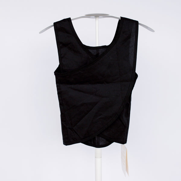 We love the cut and shape of this criss-cross tank. The detail on the back makes it very unique.