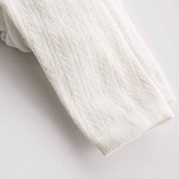 We love these cream footless textured leggings/tights!  They are a staple piece in every little girls wardrobe and perfect for church or a playdate with friends.  Light weight and perfect for all weather.