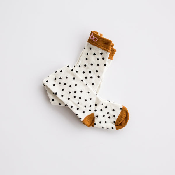 Adorable textured tights!  Add a little bit of texture and interest to any outfit with these adorable polka-dot knit tights.  Medium thickness......