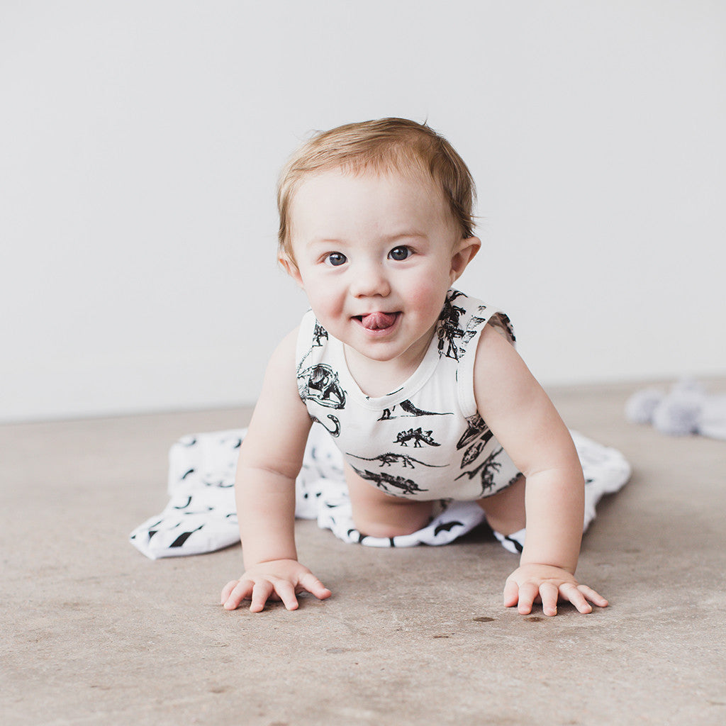 This sweet baby is modeling our Dino Onesie. We love the snap closure and tank style.