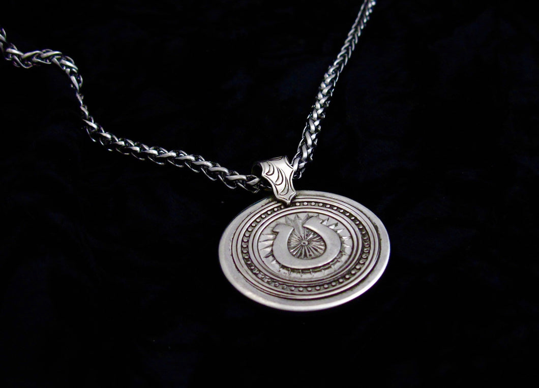 Silver stylized horseshoe pendant by Jim Brandvik