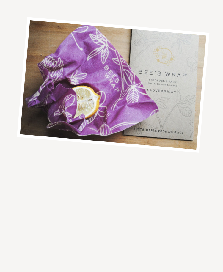 Bees Wrap assorted wraps in clover print wrap cheese on cookery book