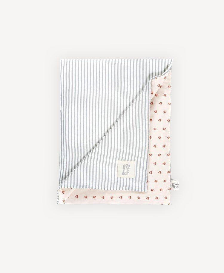 Hope & Fortune grey stripe and heart blanket folded flat lay view