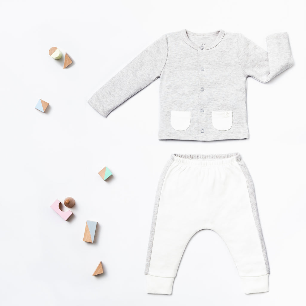 Baby Mori cardigan grey with white trousers flat lay view