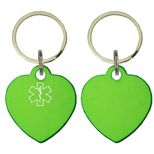 Two Green Heart Shaped Key Chains With Medical Alert Symbol