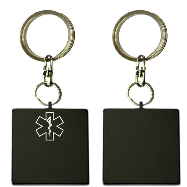 Two Black Square Shaped Key Chains With Medical Alert Symbol