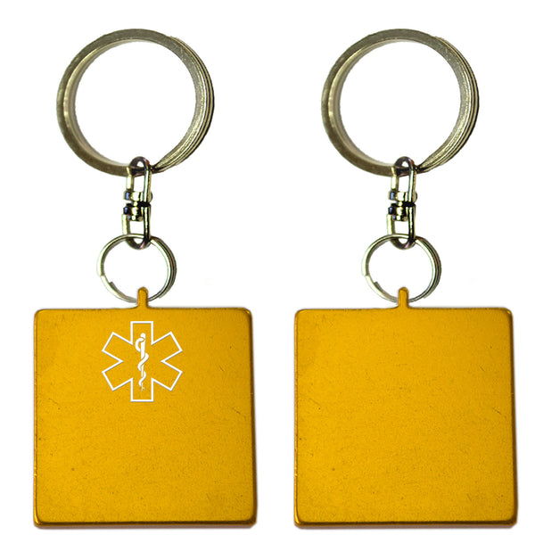 Two Gold Square Shaped Key Chains With Medical Alert Symbol