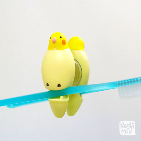 Cockatiel toothbrush holder