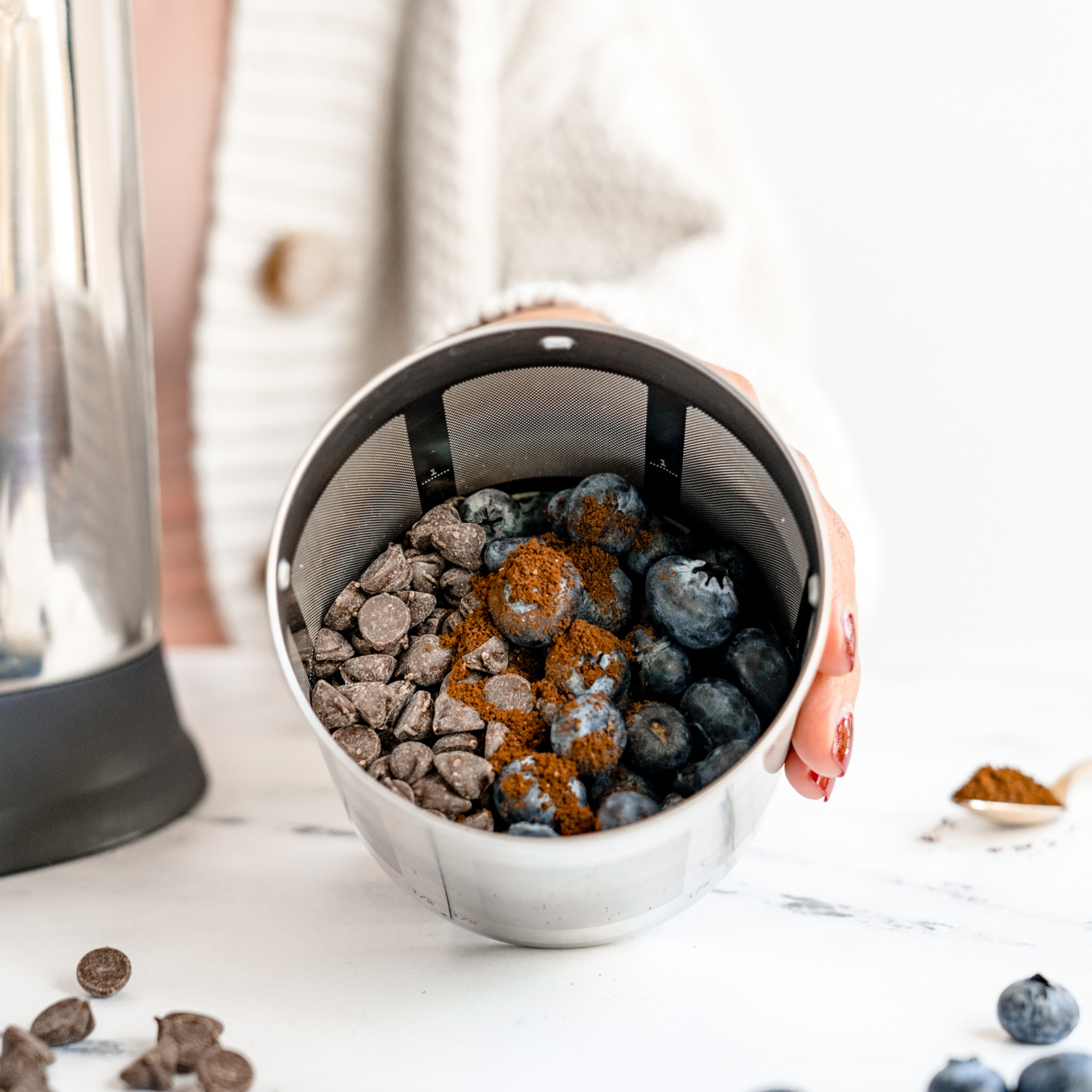 blueberries, chocolate chips, instant coffee in a Almond Cow filter basket to make a blueberry mocha infusion
