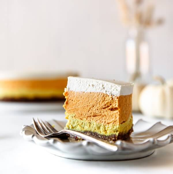 a slice of vegan Candy Corn Cheesecake